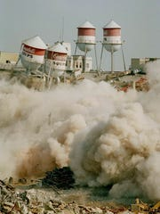 Water towers begin to fall into rubble during the implosion of a Campbell plant in downtown Camden in November 1991. The 122-year-old plant closed in 1990.