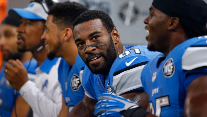 In this Nov. 26, 2015, file photo, Detroit Lions wide receiver Calvin Johnson (81) sits on the bench during the second half of an NFL football game against the Philadelphia Eagles, in Detroit.