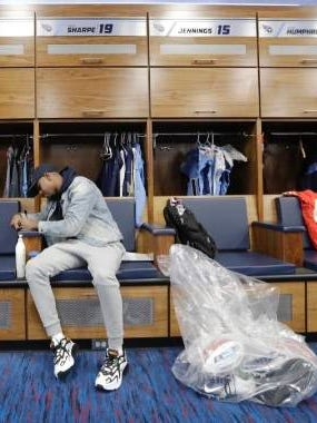Tajaé Sharpe, cleaning out his locker following the Tennessee Titans' loss to Kansas City in the AFC Championship Game, signed a free agent contract this week with the Minnesota Vikings.