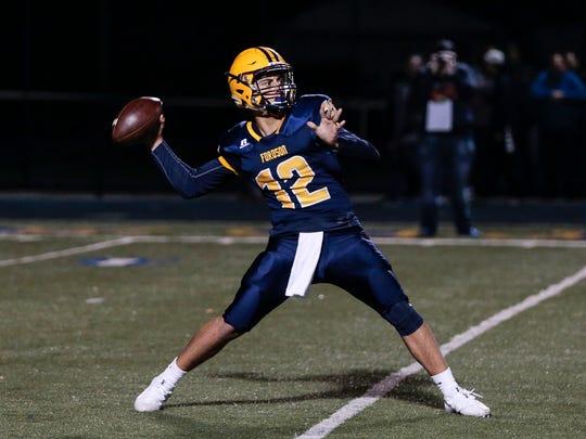 Dearborn Fordson quarterback Hussein Ajami (12) makes