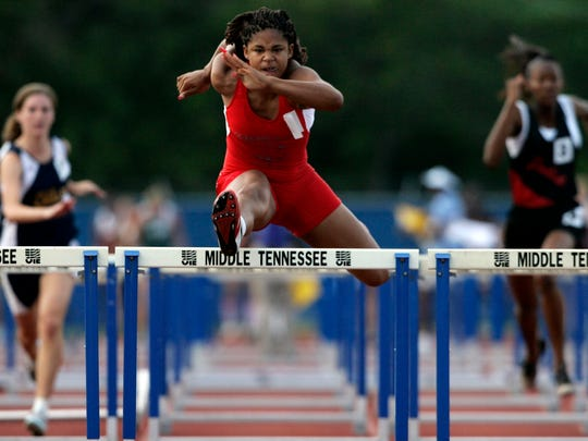 Bianca Blair of Austin-East wins the 100-meter hurdles in Class A/AA during the TSSAA State Track Meet of Spring Fling in Murfreesboro on May 24, 2006.
