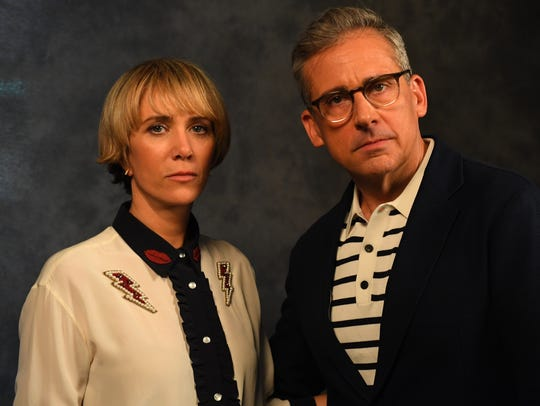 Kristen Wiig, left, and Steve Carell play crime-fighting