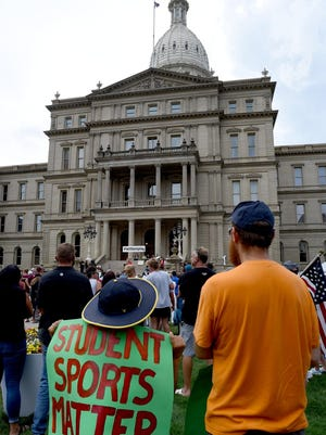 Hundreds joined in at the #LetThemPlay rally in August at the Michigan state capitol to support high school athletes. Another rally is planned for today after the state's recent three-week athletic suspension was extended to Dec. 20.