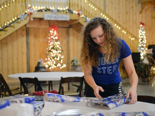 Hailey Fletcher, 16, wraps gifts at Weatherington Woods