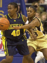 Layne Ingram, left, set numerous records at the University