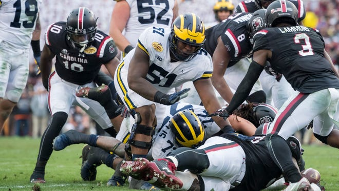 Cesar Ruiz is expected to play at center after starting six games at right guard for the Wolverines last season.