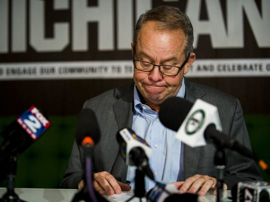 Michigan State athletic director Mark Hollis announces his retirement Friday, Jan. 26, 2018 in East Lansing, Mich.  Hollis is the second university official to step down in as many days amid sharp criticism over the school's handling of sexual abuse allegations against disgraced sports doctor Larry Nassar.   (Jake May/The Flint Journal-MLive.com via AP)