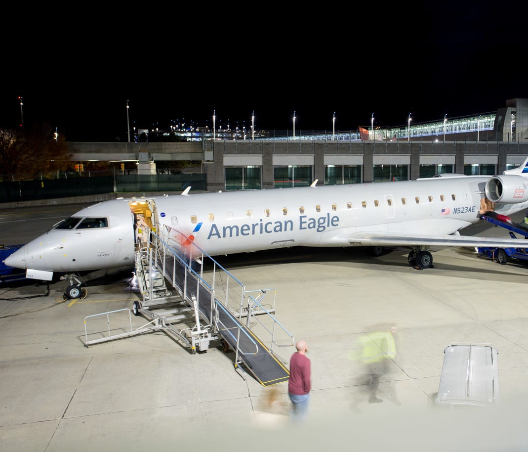 This file photo from 2016 shows fliers exiting an American Eagle Bombardier CRJ-700 at Providence's T.F. Green International Airport in Rhode Island.
