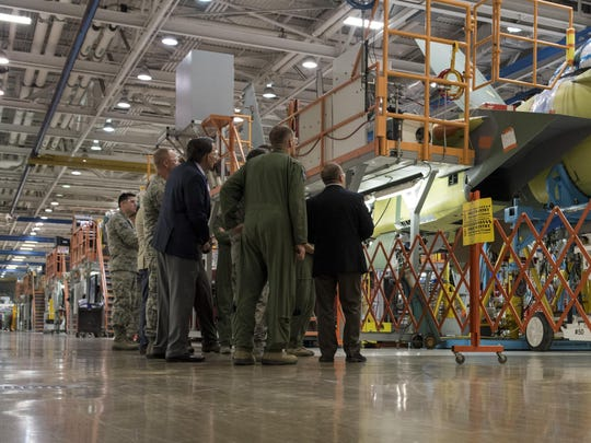 Airmen from Mountain Home Air Force Base, Idaho, tour a defense contractor's factory during a visit to St. Louis, Aug. 3, 2017. The tour showed the production of an F-15E Strike Eagle from start to finish.