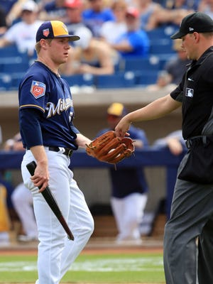Brewers pitcher Chase Anderson gets a new ball and hands over the broken bat Arizona Diamondbacks Jarrod Dyson in a game Thursday at Maryvale Baseball Park.