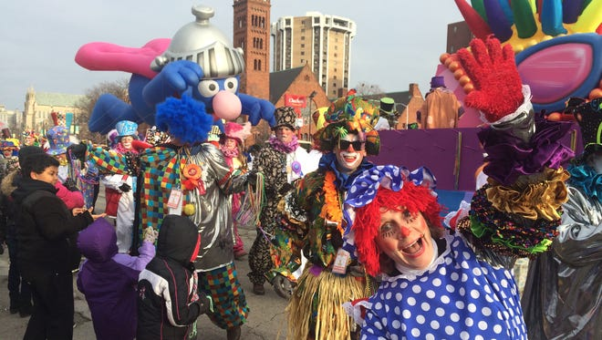 Clowns and floats and spectators mingle during America's Thanksgiving Parade in Detroit on Nov. 27, 2014.