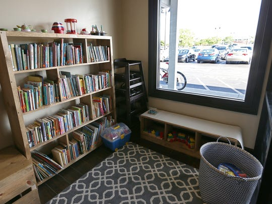 An area for kids at the new Books & Brews location in Zionsville, Ind., during its soft opening for mug club members, Wednesday, June 29, 2016. The taproom and used bookstore is open to the public July 1, 2016.