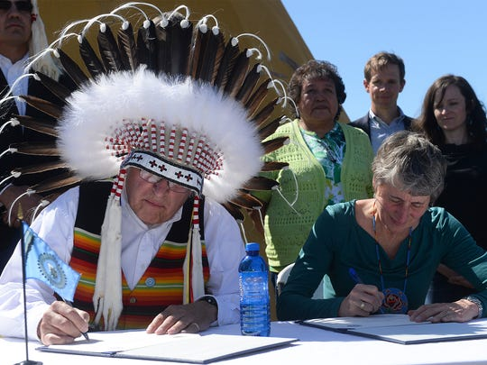 Blackfeet Tribal Council Chairman Harry Barns and Interior Secretary Sally Jewell sign land buy-back agreements during a ceremony on Tuesday, May 3, 2016, in Browning, Montana.