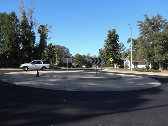 A car goes through one of the newly constructed roundabout's Thursday along Victor Ave. in Redding.