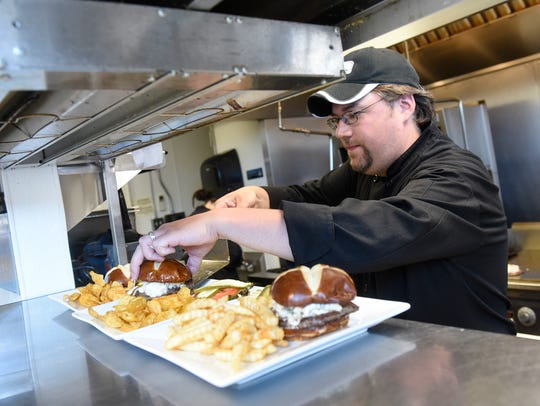 Owner Thomas Zimmerman prepares popular olive burgers