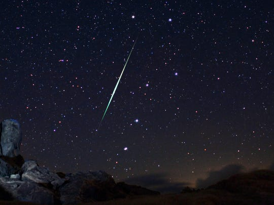 A Geminid fireball explodes over the Mojave Desert on Dec. 13, 2009.
