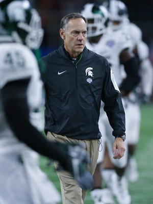 Michigan State Spartans head coach Mark Dantonio watches his team warm up before action against the University of Alabama Crimson Tide in the Good Year Cotton Bowl game Thursday, December 31, 2015 at AT&T Stadium in Arlington Texas.