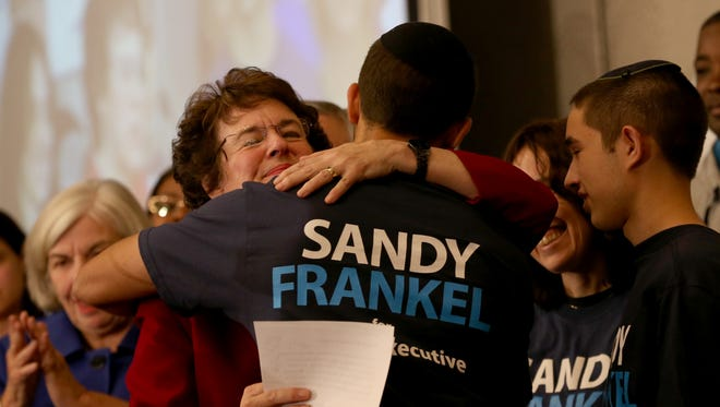 Sandy Frankel hugs one of her grandsons after her second unsuccessful bid for county executive.