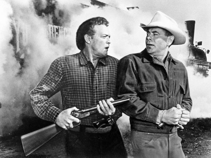 "Glenn Ford and Van Heflin star in a scene from ""3:10"