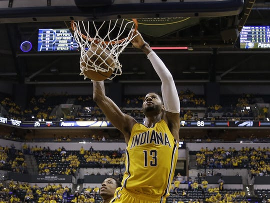 Indiana Pacers forward Paul George (13) slams the ball
