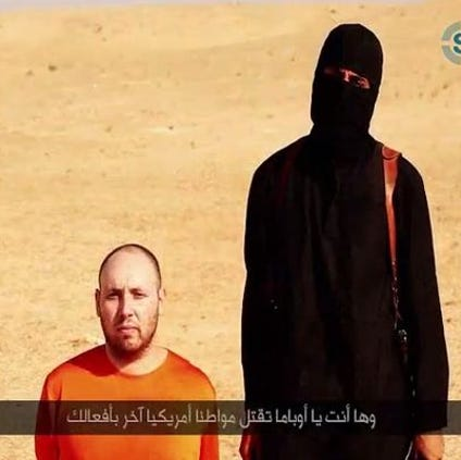 This screen grab from a video posted by the Islamic State terrorist group purportedly shows American freelance journalist Steven Sotloff, 31, moments before he is killed. The video was provided by SITE, a U.S. intelligence monitoring group.