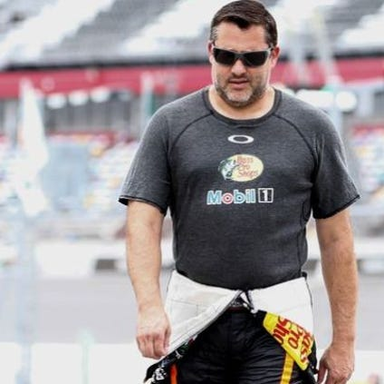 Three time Sprint Cup champion Tony Stewart walks through the pits before practice for the Coke Zero 400 last month at Daytona International Speedway.