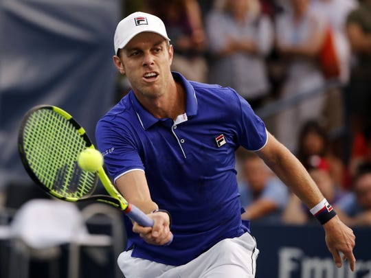 Sam Querrey of Thousand Oaks hits a shot back to Dudi Sela, of Israel, during their third-round match at the U.S. Open on Friday. Querrey won in four sets to reach the round of 16.