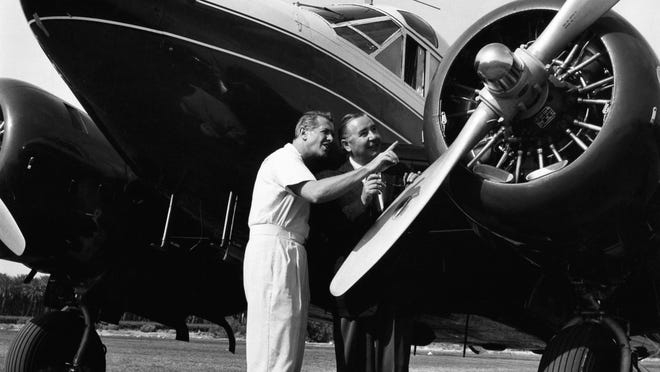Bob Cummings and Fred Beck check out Cummings' plane at the Desert Air Hotel, 1957. Photo by Lee Wenzlick.