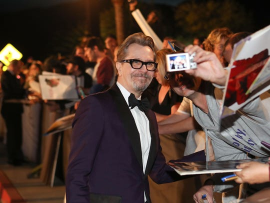 Gary Oldman interacts with fans during the Palm Springs