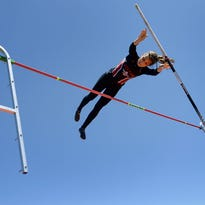 Hilton's Zoe Camillaci wins the pole vault with a height of 11-0 feet at the Monroe County Track and Field Championships held Saturday, May 23, 2015.