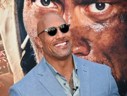 It's casual, Dwayne Johnson just has two big action movies in theaters at the same time.