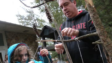 Gorman Nature Center greets families with peanut butter, pine cones and feathered friends