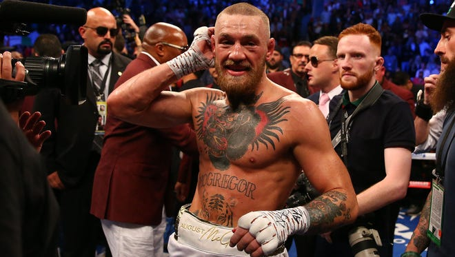 Conor McGregor reacts following his loss against Floyd Mayweather.