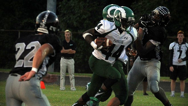 Parkside's Nayel Oge (44) breaks away from Colonel Richardson defenders Friday, Sept. 23, 2016 outside Federalsburg.