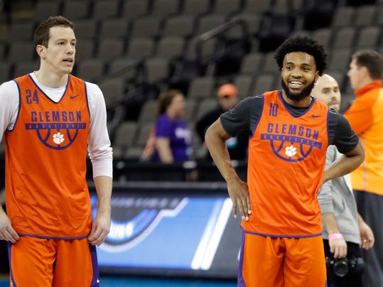 Clemson guard Gabe DeVoe, right, laughs with teammate David Skara, left, during practice at the NCAA men's college basketball tournament, Thursday, March 22, 2018, in Omaha, Neb. Clemson faces Kansas in a regional semifinal on Friday. (AP Photo/Charlie Neibergall)