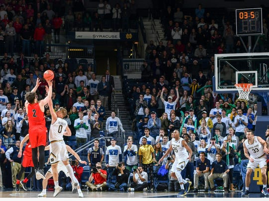 Dec 5, 2017; South Bend, IN, USA; Ball State Cardinals guard Tayler Persons (2) shoots the game winning shot over Notre Dame Fighting Irish guard Rex Pflueger (0) in the second half at the Purcell Pavilion. Mandatory Credit: Matt Cashore-USA TODAY Sports