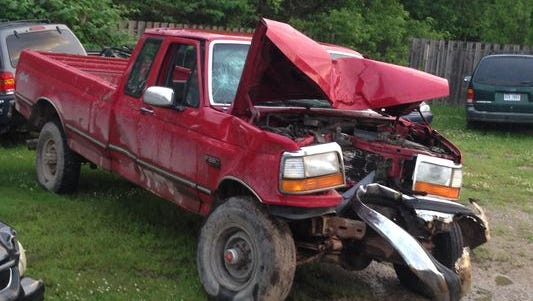 A Ford pickup truck remained in the Milford Police impound yard Wednesday, June 17, 2015, after a 15-year-old unlicensed driver reportedly lost control and struck a tree near his family's Milford Township home Monday. Two younger children were inside the truck when it crashed.