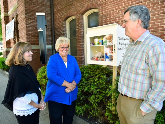 A miniature food pantry is set up in front of Central