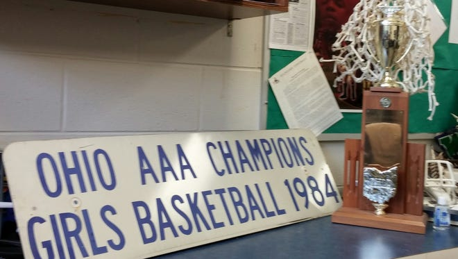 This is the 1984 Forest Park High School state AAA championship girls basketball trophy, sign and netting.