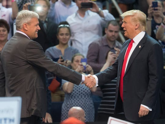 """Buffalo Bills head coach Rex Ryan, left, shakes hands with Republican presidential candidate Donald Trump on April 18, 2016.  """"He is a great, great football coach,'' Trump said, not mentioning Ryan's teams haven't made playoffs in five years."""