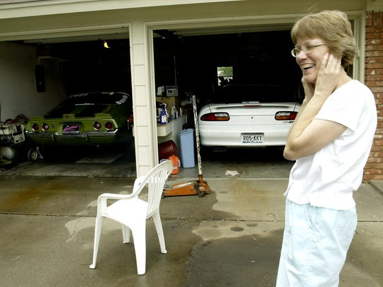 Betty Taylor reacts as her husband revs the engine