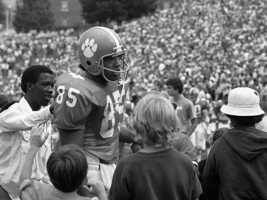 Clemson's Bennie Cunningham (85) is greeted by fans after the Tigers 17-13 loss to Tulane Saturday, September 13, 1975 at Memorial Stadium in Clemson.