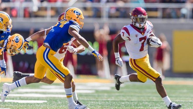 USC Trojans running back Stephen Carr (7) runs the ball against the California Golden Bears in the first quarter at Memorial Stadium.