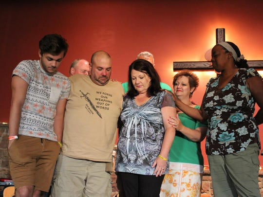Calvary Chapel of Hammonton members prayer with Dawson Coyle (left to right), David Coyle and Kathy Coyle.