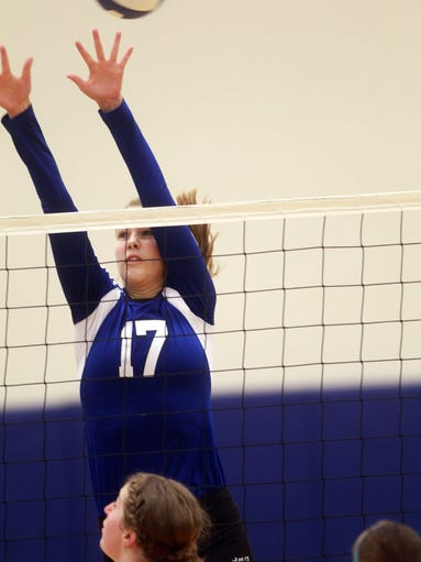 Clear Creek Amana's Ashley Prusha goes up for a block during the Clippers' game against Solon at CCA on Thursday, Aug. 28, 2014. David Scrivner / Iowa City Press-Citizen