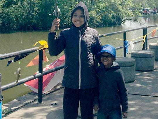 Majae Norwood, 10, and her cousin Rakai Norwood, 4, fished at the 21st annual Detroit Area Kids Fishing Derby at Palmer Park in Detroit on Saturday, May 20, 2017.
