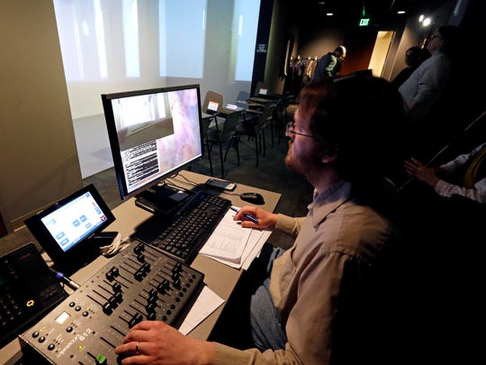 Chris Larkee, visual technology specialist, adjusts the lighting  for viewing 3D for the set of Macbeth during rehearsal.