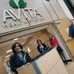Jerry Morasko, president and CEO of Avita Health System, explains the new hospital layout to Vernita Dore, deputy under secretary for rural development, during the press event at Richland Mall Tuesday.