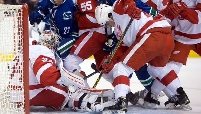Petr Mrazek makes a save behind a scrum during the first period Saturday night.