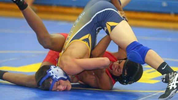 Alex Rabinowitz of Mahopac pinned Quincy Downes of